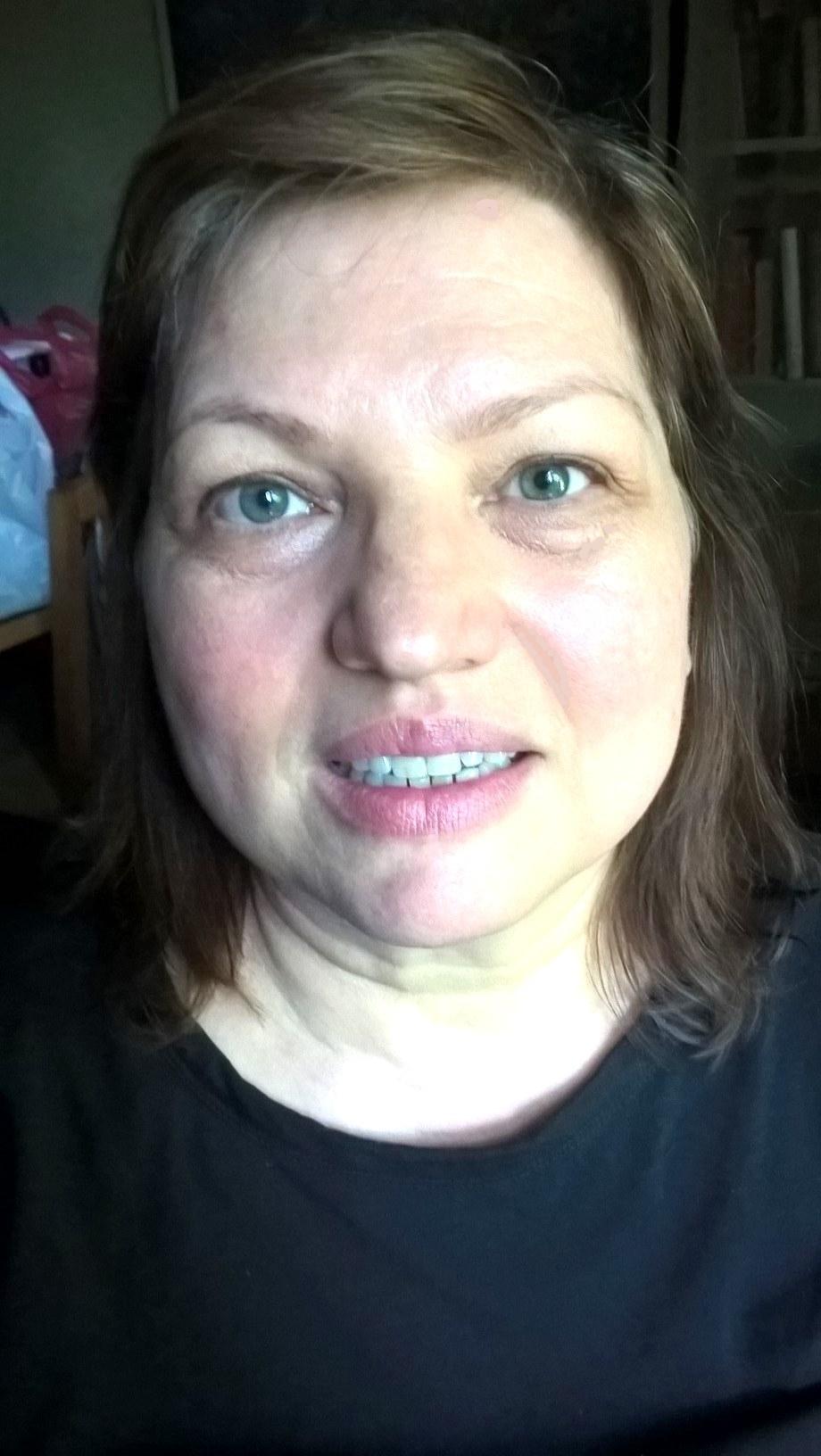 Evadeen Portrait smiling2-vertical